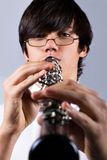The musician. Schoolboy playing the clarinet, people diversity series Royalty Free Stock Photo
