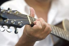 Musician. Close-up of a guitar player during a performance royalty free stock photo