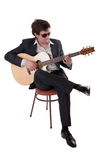 Musician with an acoustic guitar Royalty Free Stock Photo