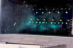 Musician Asli Gungor on a charity event in Turkish summer and vacation town central square during a public concert without press. Involved royalty free stock photography