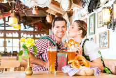 Musician in Bavarian Restaurant playing Accordion Royalty Free Stock Images