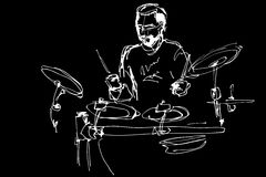 Musician with a beard plays pop drums Stock Images