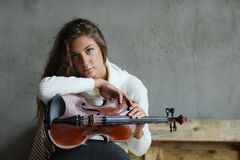 Musician. Beautiful girl with violin Stock Image