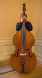 Musician behind his Upright String Bass. Musician  standing directly behind his instrument, a String Upright Bass Royalty Free Stock Photo