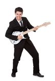 Musician in black. Young guitar player dressed in black and singing Royalty Free Stock Image