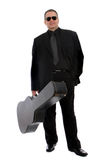 Musician in black suit Stock Images