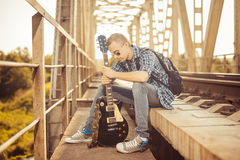 Musician on a bridge Stock Images