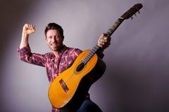 Musician with classic guitar. Studio portrait of a happy musician or singer with classic guitar Royalty Free Stock Photo