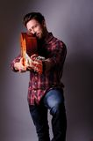 Musician with classic guitar Royalty Free Stock Photography