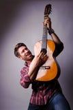 Musician with classic guitar Stock Photos