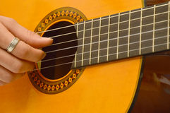A musician in the classical guitar Stock Photography