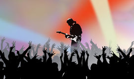 Musician in concert. A concert illustration with a musician playing in the middle of a silhouetted crowd Stock Photos