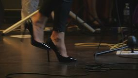 Legs of performer on the stage on the concert