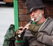 Musician In Dingle Ireland. Busking musician with soprano recorder in Dingle Ireland Royalty Free Stock Photography