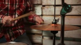 Musician with drumsticks playing drums and cymbals stock video footage