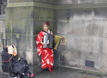 Musician at Edinburgh Fringe Festival. Young Asian woman plays accordion on Royal Mile during Edinburgh Fringe Festival Royalty Free Stock Photos