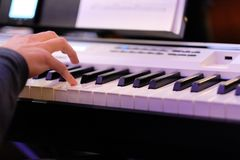 Musician on electric piano plays in the orchestra live music. In the restaurant Stock Photography