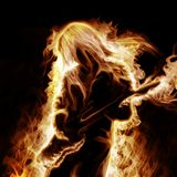 Musician with an electronic guitar. Burning in flame Royalty Free Stock Image