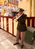 Musician entertaining the visitors. In 40's costume at the East Lancs Railway 40's weekend. Lancashire, UK royalty free stock photography