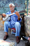 A musician entertains tourists at Kaleici in Antalya in Turkey. Stock Images