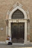 Musician in front of San Gregorio church Royalty Free Stock Image