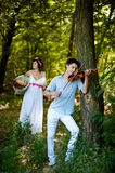 Musician and a girl Royalty Free Stock Photography