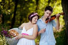 Musician and a girl Royalty Free Stock Photos