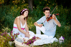 Musician and a girl Royalty Free Stock Photo