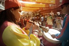 Musician girl blowing pipe on parade in Chinese New Year Celebrations in Thailand. stock photography