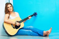 Musician girl with guitar. 60s style hippie woman portrait Stock Photo