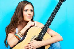 Musician girl with guitar. 60s style hippie woman portrait Stock Photography