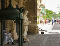 Musician. Great musician below the columns, in old havana. Cuba royalty free stock image