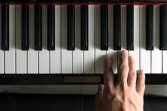 Musician hand on piano Royalty Free Stock Image