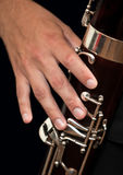 Musician hand playing the bassoon Stock Photos