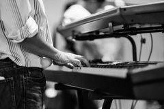 Musician hand playing electric piano. Keyboard black and white photo Royalty Free Stock Photo