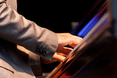 Musician hand playing piano royalty free stock photos