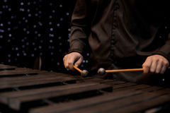 Musician hand playing the xylophone Stock Photo
