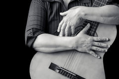 Musician hand sholding a classic guitar Royalty Free Stock Image