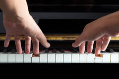 Musician hands on piano Stock Photography