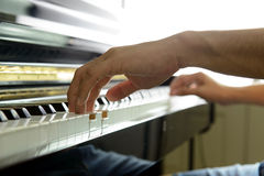 Musician hands on piano Stock Image