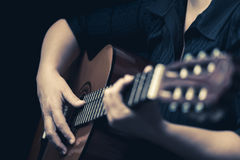 Musician hands playing an acoustic guitar Stock Photo