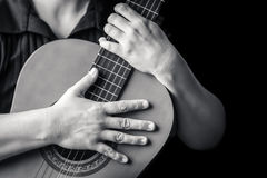 Musician hands playing a classic guitar Stock Photos