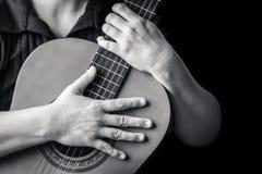 Musician hands playing a classic guitar Stock Photos