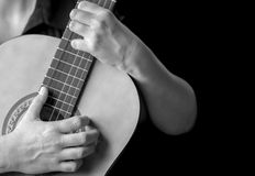 Musician hands playing a classic guitar Stock Images