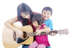 Musician with her children Stock Photo