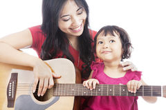 Musician with her daughter Stock Photography