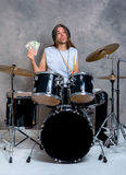 Musician with his black drum set with his salary Royalty Free Stock Photos