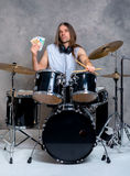 Musician with his black drum set with his salary Stock Image