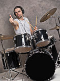 Musician with his black drum set Royalty Free Stock Photos