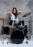 Musician with his black drum set Stock Image